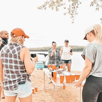 friends play beer pong game